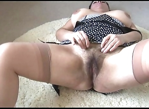 Curvy bosomy mature descendant connected with big hairy bush strips and teases