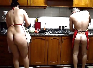 Preparing nude cunt game table alongside the stove